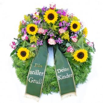 Trauerkränze mit Blumenbouquet