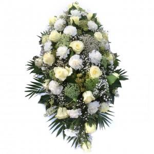 Weißer Traum mit Rosen und Nelken als Trauergesteck